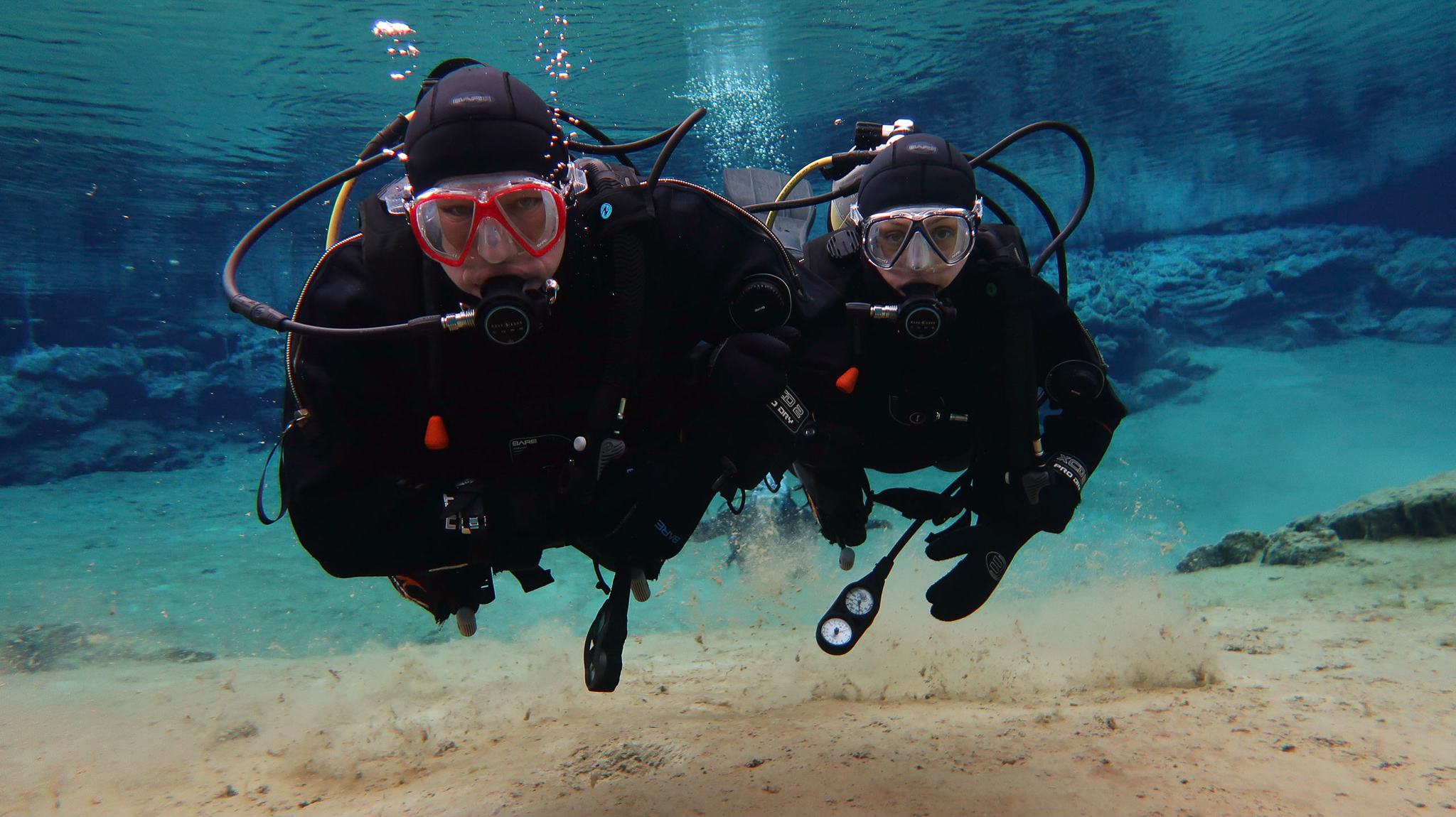 Des & Belinda diving at Silfra Fissure in Thingvellir National Park, Iceland. 
